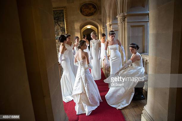 Debutantes relax before they rehearse their entrance and curtsey at the start of the Queen Charlotte's Ball at Highclere Castle on September 13 2014...
