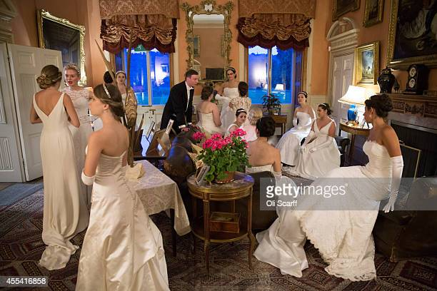 Debutantes relax before they take their places for a meal during the Queen Charlotte's Ball at Highclere Castle on September 13 2014 near Newbury...