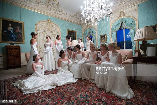 Debutantes relax before they take their places for a meal during the Queen Charlotte's Ball at Highclere Castle on September 13, 2014 near Newbury,...