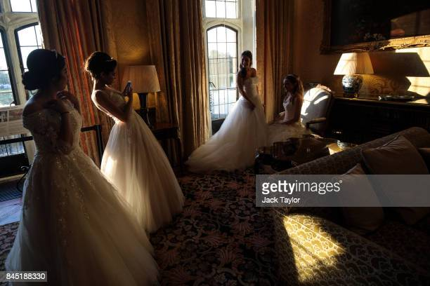 Debutantes take pictures at Leeds Castle during the Queen Charlotte's Ball on September 9 2017 in Maidstone England In 1780 the first debutante's...