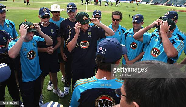 Debutants Phil Hughes Marcus North and Ben Hilfenhaus of Australia try on their Baggy Green Caps after being presented with them by captain Ricky...