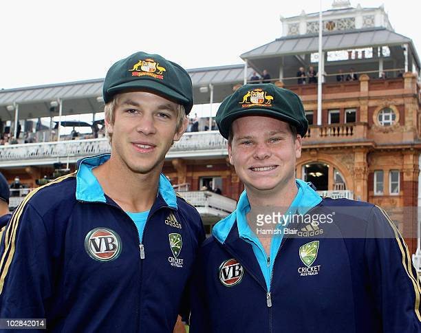Debutants Tim Paine and Steven Smith of Australia with their Baggy Green Caps ahead of day one of the First Test between Pakistan and Australia at...