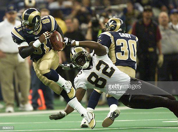 AzZahir Hakim of the St Louis Rams runs by Eddie Williams of the New Orlean sSaints during the first half of the St Louis Rams at New Orleans Saints...