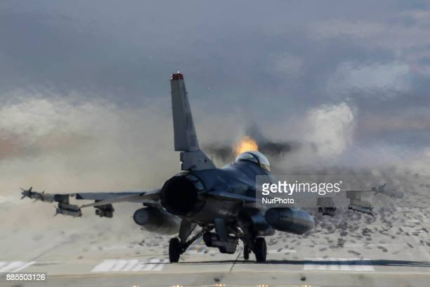 Dec 04 2017Osan South KoreaUnited States Airforce F16 landing on the runway during an VIGILANT ACE18 exercise at Osan Military Airbase in Pyeongtaek...