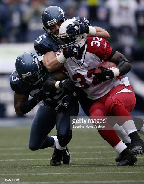Dec 09 2007 Seattle Washington USA The Arizona Cardinals EDGERRIN JAMES against the Seattle Seahawks BRIAN RUSSELL and MARCUS TRUFANT at Qwest Field...