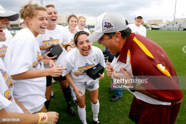 USC head coach Ali Khosroshahin laughs with his players after getting drenched with the water cooler following the Trojans 20 win over Florida State...