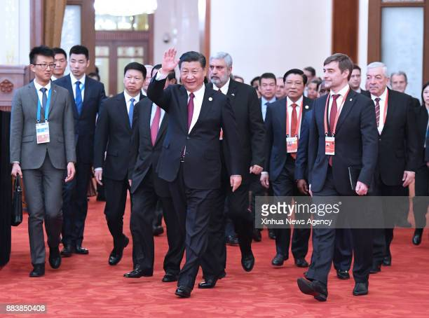 BEIJING Dec 1 2017 Xi Jinping general secretary of the Communist Party of China Central Committee walks with foreign guests to attend the opening...