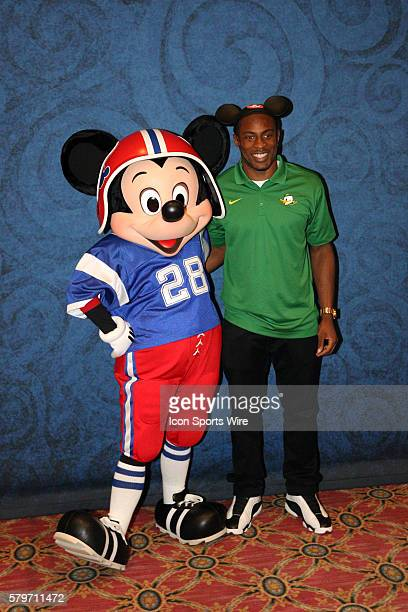 Dec 10 2014 Lake Buena Vista FL USA Oregon Ducks Ifo EkpreOlomu poses for a picture with Mickey Mouse prior to the Home Depot College Football Awards...