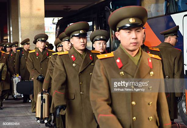 BEIJING Dec 10 2015 Members of the State Merited Chorus and the Moranbong Band from the Democratic People's Republic of Korea arrive at the railway...