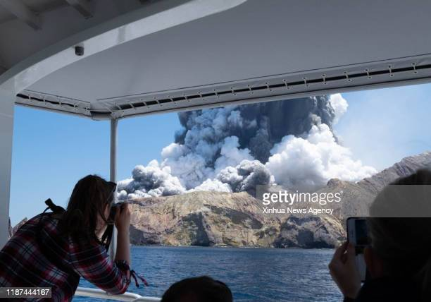 ZEALAND Dec 10 2019 A person takes photos of volcanic eruption at New Zealand's White Island Dec 9 2019 Five people were confirmed dead in a volcanic...