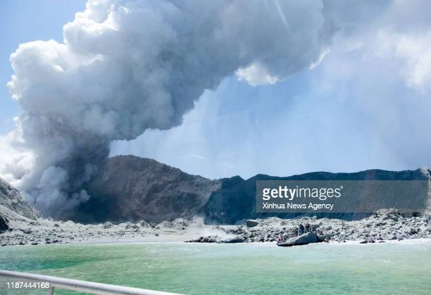 ZEALAND Dec 10 2019 Photo taken on Dec 9 2019 shows the heavy smoke from volcanic eruption at New Zealand's White Island Five people were confirmed...