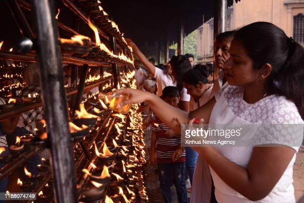 COLOMBO Dec 11 2019 Buddhist devotees are seen in the Kelaniya Temple in Kelaniya Sri Lanka on Dec 11 to celebrate the Poya day