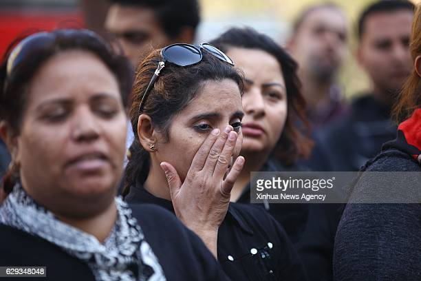 CAIRO Dec 12 2016 A woman cries during a gathering by mourners of the Cairo church bombing victims in Cairo Egypt on Dec 12 2016 A bomb went off...