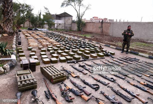 SYRIA Dec 12 2018 Confiscated weapons and ammunition are seen at a military base in Syria's southern province of Daraa on Dec 12 2018 The Syrian army...