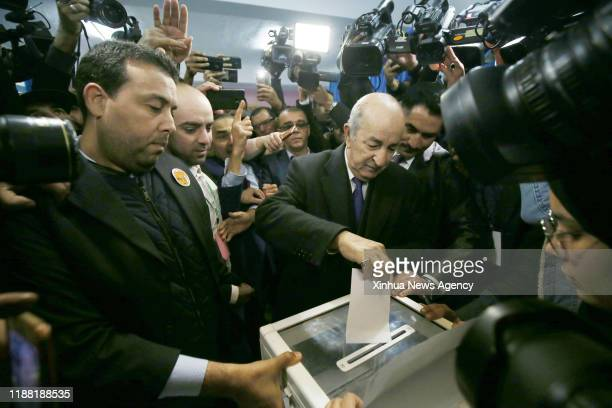 ALGIERS Dec 12 2019 Algerian presidential candidate Abdelmadjid Tebboune C casts his vote at a polling station in Algiers Algeria on Dec 12 2019...