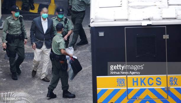 Dec. 12, 2020 -- Jimmy Lai Chee-ying is taken under police escort to the West Kowloon Magistrates' Courts for trial, in Hong Kong, south China, Dec....