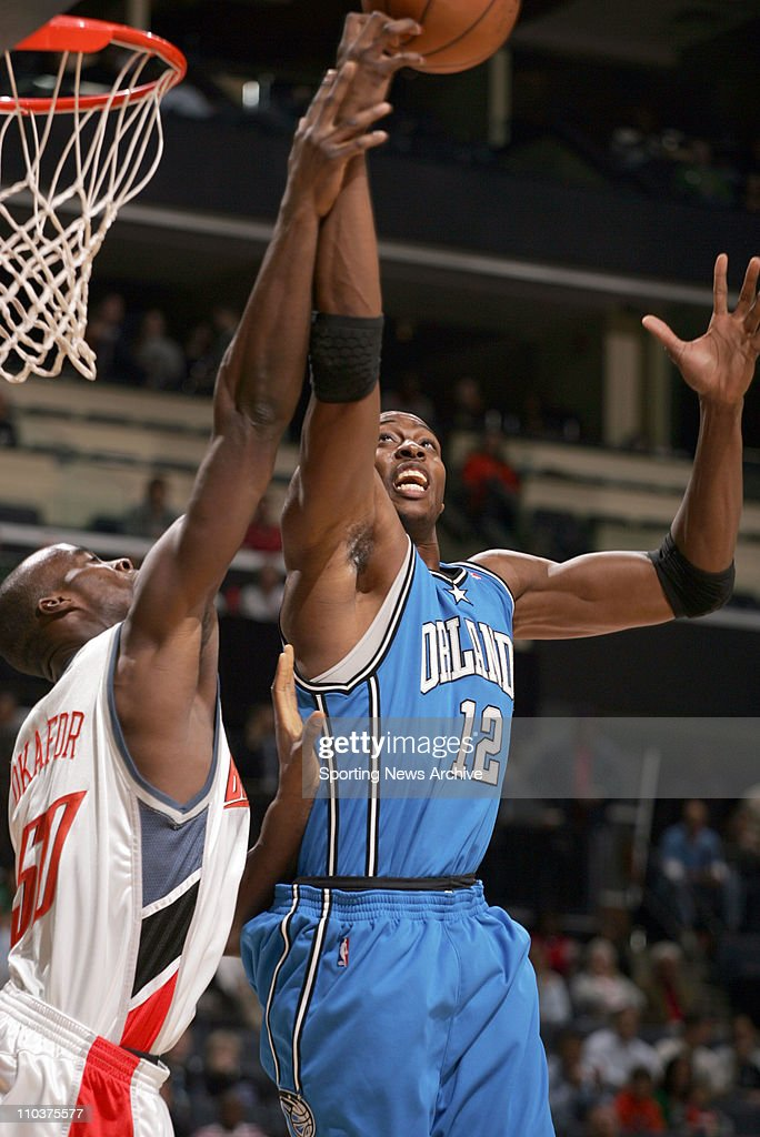 Dec 14, 2007 - Charlotte, North Carolina, USA - NBA Basketball: Orlando Magic's DWIGHT HOWARD fights for a rebound against Charlotte Bobcats EMEKA OKAFOR on Dec. 14, 2007 in Charlotte, NC. The Orlando Magic won 103-87.