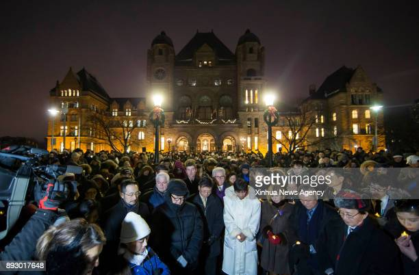 TORONTO Dec 14 2017 People take part in the moment of silence during the public candlelight vigil event marking the first Ontario's Nanjing Massacre...