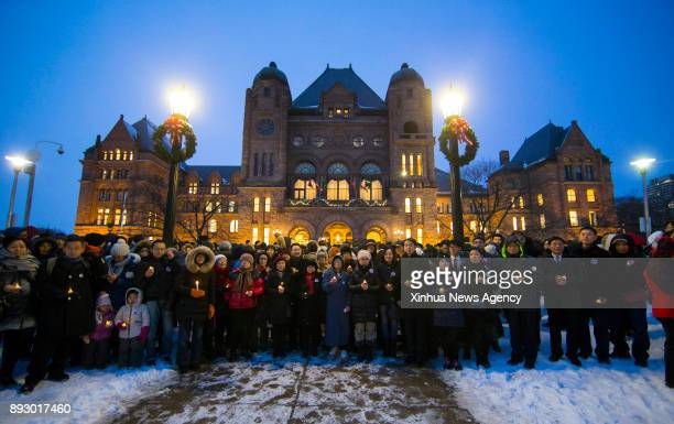 TORONTO Dec 14 2017 People take part in the public candlelight vigil event marking the first Ontario's Nanjing Massacre Commemorative Day in front of...
