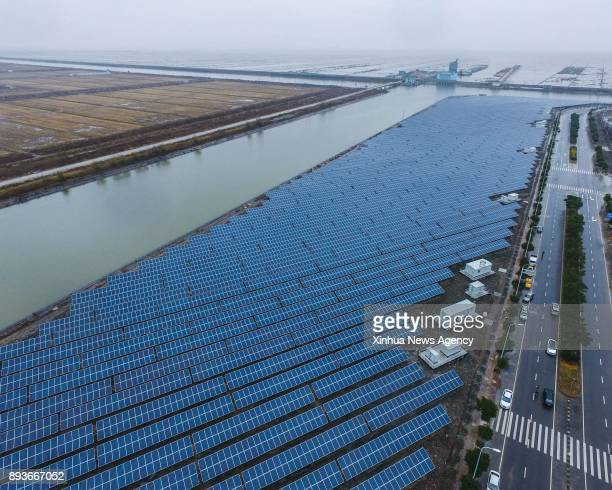 CIXI Dec 15 2017 Photo taken on Dec 15 2017 shows a photovoltaic power station built on salinealkali soil in Cixi City east China's Zhejiang Province...