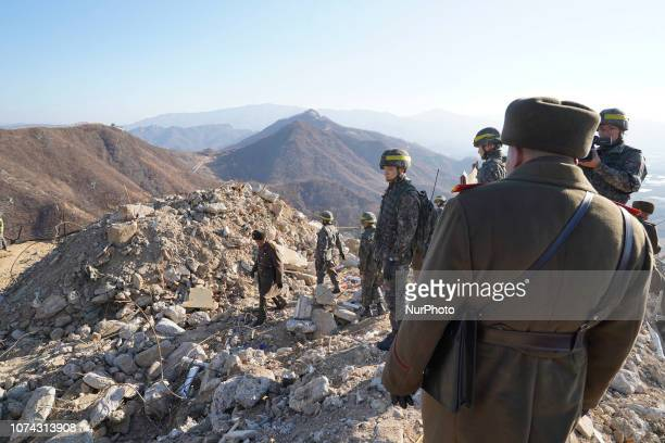 Dec 17 2018Cheorwon South KoreaIn this photo provided by South Korea Defense Ministry a South Korean and North Korean army soldier takes a inspect at...