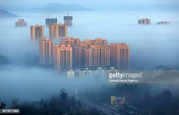 CHONGQING Dec 18 2015 Photo taken on Dec 17 2015 shows buildings shrouded by clouds in Chongqing southwest China