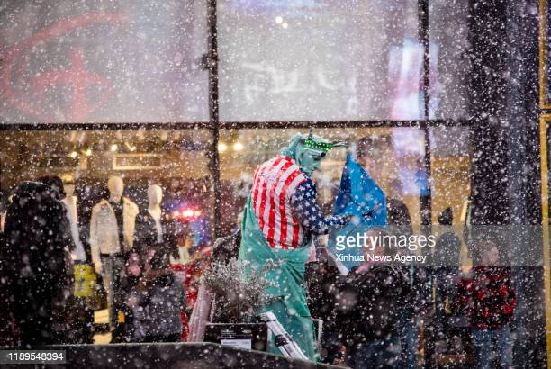 NEW YORK Dec 18 2019 A costumed character waits for business at Times Square in New York the United States Dec 18 2019 A sudden snow squall hit New...