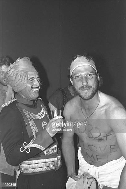 Geoff Boycott and Ian Botham share a joke at the England fancy dress party in Delhi where Botham had come dressed as Boycott Boycott had just passed...