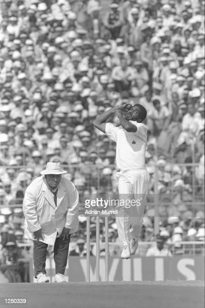Michael Holding of the West Indies bowls during the 5th Test against India in Calcutta The umpire is Swaroop Mandatory Credit Adrian Murrell/Allsport...