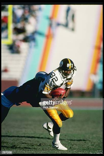 Wide receiver John Stallworth of the Pittsburgh Steelers moves the ball during a game against the Los Angeles Raiders at the Los Angeles Memorial...