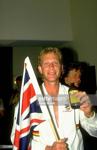 Graham Dilley of England carries the Union Flag after the Fourth Ashes Test match against Australia at the Melbourne Cricket Ground in Melbourne...