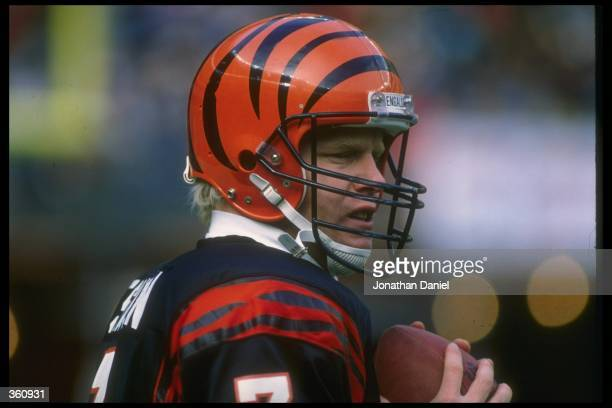Quarterback Boomer Esiason of the Cincinnati Bengals looks on during a game against the Washington Redskins at Riverfront Stadium in Cincinnati Ohio...