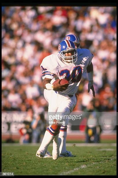 Running back Steve Sewell of the Denver Broncos moves the ball during a game against the Los Angeles Raiders at the Coliseum in Los Angeles...