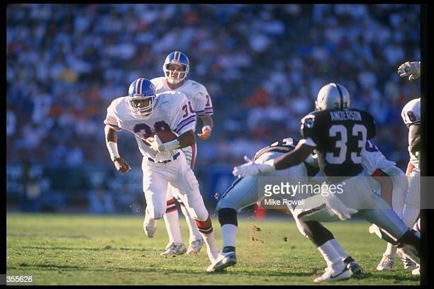 Running back Steve Sewell of the Denver Broncos runs with the ball during a game against the Los Angeles Raiders at the Coliseum in Los Angeles...