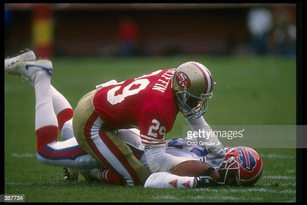 Defensive back Don Griffin of the San Francisco 49ers tackles a Buffalo Bills player during a game at Candlestick Park in San Francisco California...