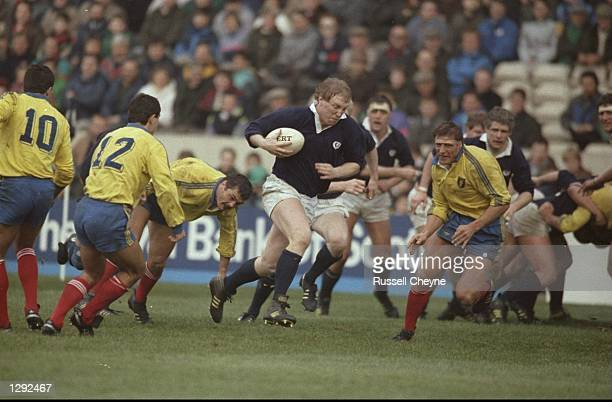 Derek White of Scotland breaks through the Romanian defence and runs in for a try during the match at Murrayfield in Edinburgh Scotland Scotland won...