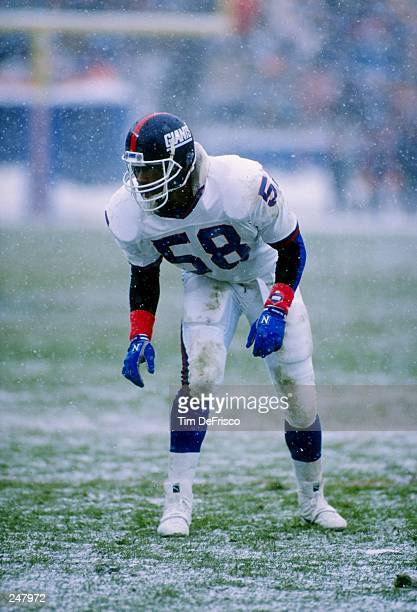 Linebacker Carl Banks of the New York Giants in action during a game against the Denver Broncos at Mile High Stadium in Denver Colorado The Giants...