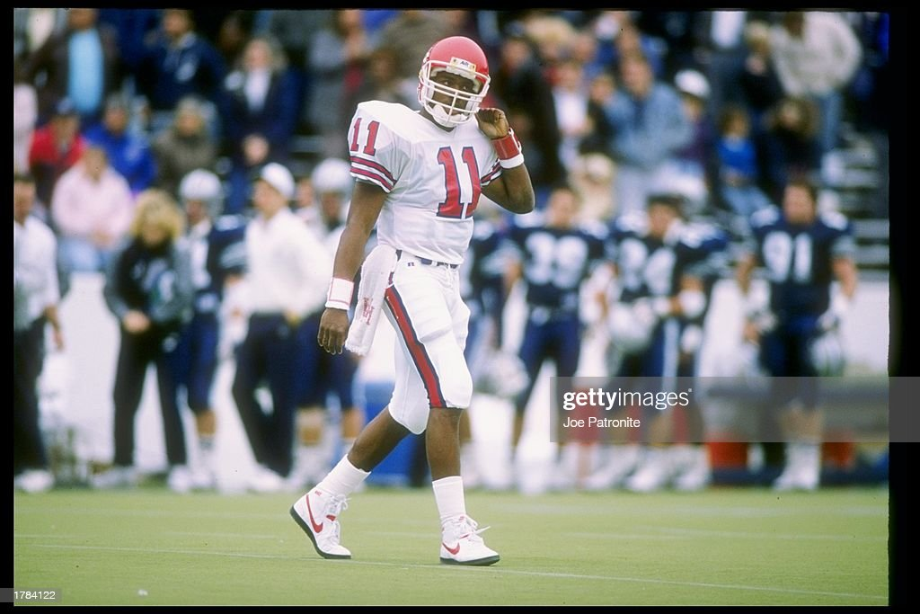 Quarterback Andre Ware #11 of the Houston Cougars in action during a game against the Rice Owls in Houston, Texas. The Houston Cougars won the game 64-0.