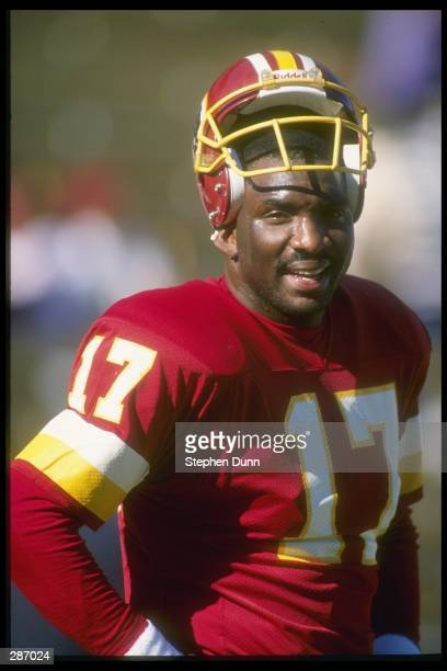 Quarterback Doug Williams of the Washington Redskins takes a photo opportunity during a game with the Arizona Cardinals at the Sun Devil Stadium in...