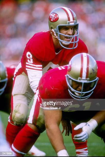 Quarterback Steve Young of the San Francisco 49ers calls the cadence during a game against the Buffalo Bills at Candlestick Park in San Francisco...