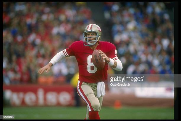 Quarterback Steve Young of the San Francisco 49ers looks to pass the ball during a game against the Buffalo Bills at Candlestick Park in San...