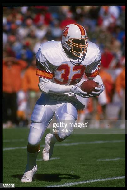 Running back James Wilder of the Tampa Bay Buccaneers runs with the ball during a game against the Pittsburgh Steelers at Three Rivers Stadium in...