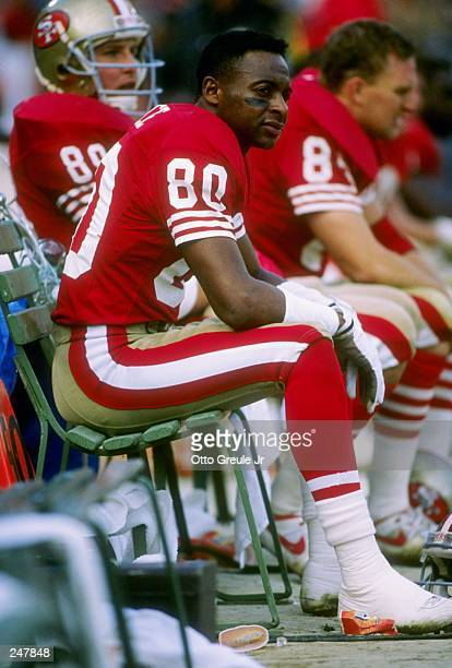Wide receiver Jerry Rice of the San Francisco 49ers sits on the bench during a game against the Buffalo Bills at Candlestick Park in San Francisco...