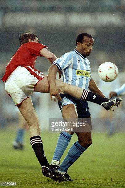 Cyrille Regis of Coventry City takes on Gary Pallister of Manchester United during a Barclays League Division One match at Highfield Road in Coventry...