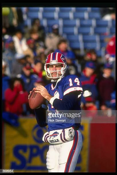 Quarterback Frank Reich of the Buffalo Bills looks to pass the ball during a game against the Philadelphia Eagles at Rich Stadium in Orchard Park,...