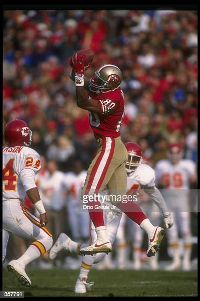 Wide receiver Jerry Rice of the San Francisco 49ers catches the ball during a game against the Kansas City Chiefs at Candlestick Park in San...