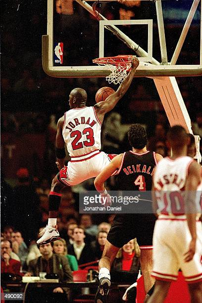 Michael Jordan of the Chicago Bulls dunks the ball during the game against the Miami Heat Mandatory Credit Jonathan Daniel /Allsport