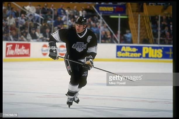 Center Wayne Gretzky of the Los Angeles Kings moves down the ice during a game against the Buffalo Sabres at Memorial Auditorium in Buffalo New York...
