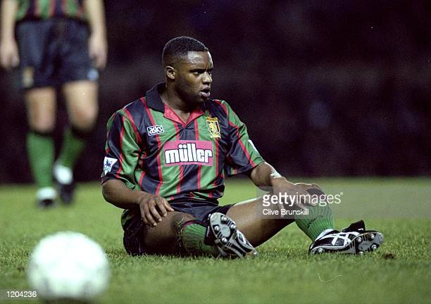 Dalian Atkinson of Aston Villa sits on the pitch during a match Mandatory Credit Clive Brunskill/Allsport