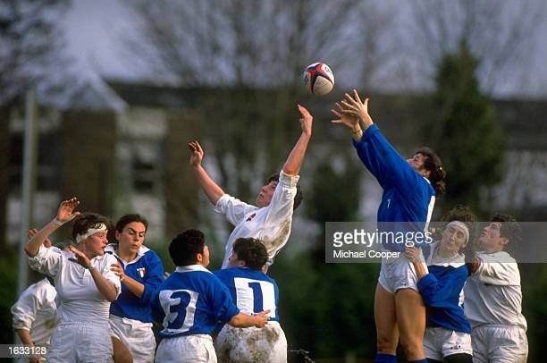 Janis Ross of England and Christina Boncilli of Italy jump to win the ball in a lineout during the Women's International match Mandatory Credit Mike...